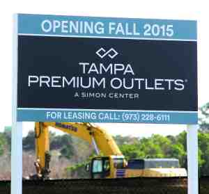 This is a sign letting people know that Tampa Premium Outlets will be opening this fall. (Fred Bellet/Photo)