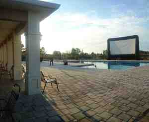 The poolside area at Avalon Park West becomes an outdoor movie theater once a month. (Courtesy of Avalon Park West)