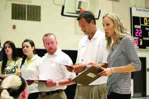 Volleyball coach Kim Whitney, right, gets help from assistants Brian Kachurak, Chris Vergnaud and Kristen Wimer on game days and throughout the season. But it all starts with the coach, who has captured yet another Coach of the Year award. (Courtesy of Pasco-Hernando State College)