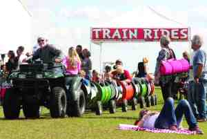 Children rode the 'rails' at the Pigz in Z'Hills BBQ and Blues Fest on Jan. 17. The event was sponsored by the Greater Zephyrhills Chamber of Commerce, which has donated $15,000 to local youth and civic groups. (File Photo)