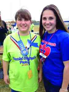 Regan Black, left, and her sister, Sydney Black, have always had a close relationship. They're the inspiration behind Sydney Has A Sister, which provides scholarship money to students who have a sibling with autism. (Courtesy of Becky Black)