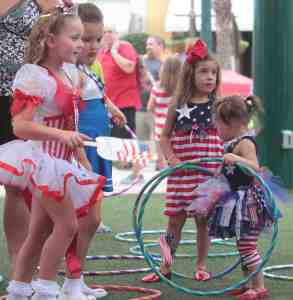 Some of the older contestants took to a little exercise with Hula Hoops before the start of the Freedom Fest Little Miss & Mr. Firecracker pageant.