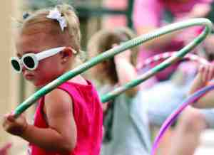 Two-year-old Jaycee Watkins, of Wesley Chapel, gets in a little exercise prior to her stage appearance for the Little Miss & Mr. Firecracker Pageant. She was there with her mom, Casie Watkins, of Wesley Chapel.