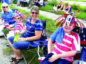 Bridget Richwine, second from right, helped her sons get into the Fourth of July spirit with hats she made for C.J., 11, at right, and Ben, 5. Grandmother Chloie Adkins, far left, looks on. They were at the Fourth of July celebration in Lutz last year. (File Photos)