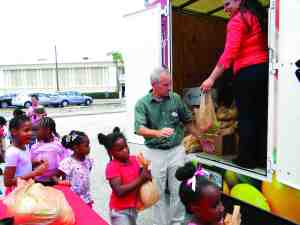 A summer youth camp for children ages 5 and 6 hiked over from the Bob Gilbertson Central City YMCA in Tampa to get bags of vegetables to take home.