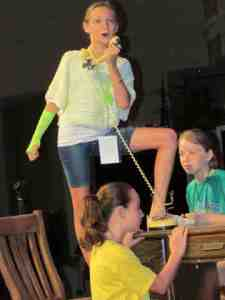 Kaitlyn DeTuccio belts out a number during a rehearsal at Summer Sing, a weeklong summer camp at Exciting Idlewild Baptist Church, which was jammed with fun stuff for kids. Also in rehearsal are Alexis Davis, in yellow, and Meghan Reilly. (B.C. Manion/Staff Photos)