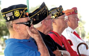 Veteran Bill Hansberger of American Legion Post 118, left, wipes his eyes at the memorial service at Zephyr Park honoring the victims of 9/11. Next to him are fellow post members, George Hansen, Keith Holz and Gil Shepard, far right, of the Marine Corp League's Sgt. Maj. Michael S. Curtin Detachment #1124. (Fred Bellet/Photos)