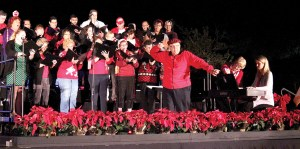 Marvin Robertson, director of the Florida Hospital Zephyrhills Chorale, is shown here leading the chorus, during last year's Christmas Tree Lighting ceremony at the hospital. The community chorus is gearing up for a Nov. 21 public performance, focusing on the theme of Thanksgiving. (Courtesy of Florida Hospital Zephyrhills)