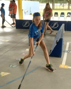 Makenna Rice, of Chester Taylor Elementary School, focuses as she handles her hockey stick during a street hockey clinic at her school. The Tampa Bay Lightning is trying to increase awareness about the game of hockey through a partnership with Tampa Bay area schools.