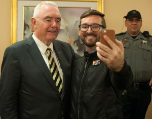 Retired U.S. Gen. Barry McCaffrey poses for a selfie with Saint Leo University student James Campbell.
