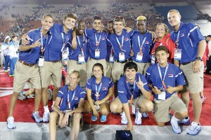 The Land O' Lakes Special Olympics unified soccer team pose with their coach, Vicky King, and with the bronze medals they won at the Special Olympics World Games in Los Angeles. The team defeated China, 2-1.