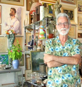 Johnny Herrmann enjoys being surrounded by items he's purchased at estate sales, other antiques stores and from individual sellers. He has a particular weakness for paintings. He just loves having them around. (B.C. Manion/Staff Photo)