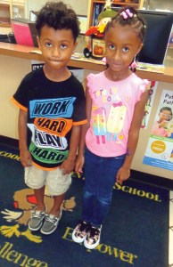 Lachoochee Elementary School students, Damarko Cross, 5, and his sister, Demyia Cross, 7, show off the new shoes they got from COPE (Children Outreach Program Effort). (Courtesy of COPE)