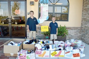 Owen Matthew, left, and Grady Matthew challenged students and families at Countryside Montessori Charter School to a sock drive that collected 1,552 socks for the Salvation Army. (Courtesy of Countryside Montessori Charter School)