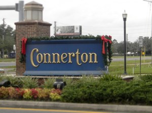 The sign at the entrance to Connerton is decorated for the holidays. The master-planned community is seeing an uptick in housing sales.
