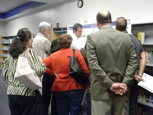 Residents listen as Michael Campo, roadway project engineer with Kisinger Campo & Associates, answers questions about the proposed road design for County Road 54. (Kathy Steele/Staff Photo)