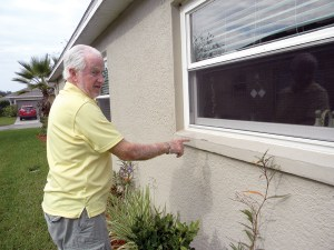 John Hart points out a chipped window at his home in Tampa Bay Golf & Country Club. He believes that vibrations coming from truck traffic on Interstate 75 cause damage to both his home and his neighbors' homes. (Kathy Steele/Staff Photos)