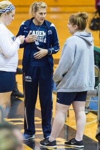 Academy at the Lakes girls weightlifting coach Maria Oliver provides some encouragement and tips to senior Grace Faith during the district meet. (Photos courtesy of Jim Faith)