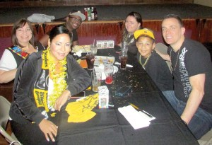 Before Steelers games, tables at O'Brien's are reserved for members of the Bay Area Black and Gold Club. Seated counterclockwise at the table: Melinda James, Sarah Scarborough, Jeremy Frazier, Bre Urrel, Ray James and Shawn Honner. (Kevin Weiss/Staff Photo)