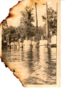 Members of the First Baptist Church of Lutz used to be baptized in lakes. This shot was taken of a group being baptized in Lake Keen. The edges of the photograph are charred, because the photo was salvaged after Joan Fletcher's house burned down. (Courrtesy of Joan Fletcher)