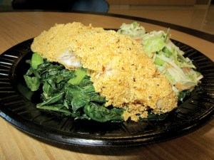 Louisiana-seasoned fried catfish with sautéed greens and coleslaw are a staple at Twigs Café.