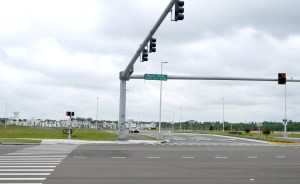 The southern half of Wesley Chapel Boulevard is a short section of paved road that intersects with Grand Cypress Drive, an entry road into the Tampa Premium Outlets. (Kathy Steele/Staff Photos)