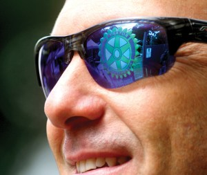 The inflatable Rotary International sign is reflected in the sunglasses of Geoff Kranich, a member of the Rotary Club of Trinity. Kranich helped Erin Meyer, president of the Wesley Chapel Rotary, install the inflatable sign at the entrance to the Duck Derby.