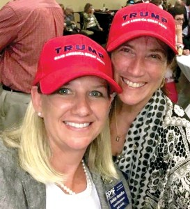Debbie Hannifan, of Polk County, left, and Sandy Graves, of Land O' Lakes, sport 'Trump Make America Great Again' ball caps at the quarterly session of the Republican Party of Florida meeting in Tampa on May 14. (Courtesy of Sandy Graves)