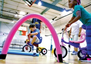 Children line up for their turn on the tricycle course during the Pee Wee Olympics, at the Land O'Lakes Recreation Complex on Collier Parkway.