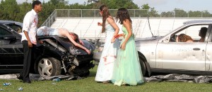 Emerging dazed and confused from the crash, the drunk driver (left) St. Paul Allen, 17, a junior, and two occupants of the other vehicle try to make sense of what had happened during Prom Promise, a dramatization of a drunk driving accident.