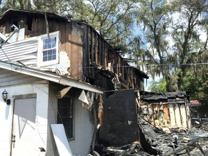 Fire ravaged the DeRolf's family home in Lutz. Persistent barking by the family's dog, Peanut, alerted the family to the fire. Peanut perished from smoke inhalation. (Suzanne Beauchaine/Staff Photo)