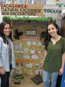 Isabella Torres, of Wesley Chapel, and Lauren Pinero-Colon, of Land O' Lakes, are traveling to College Park, Maryland, to competed in the National History Day competition. Their exhibit, behind them, has been selected to represent the state of Florida in a display at The Smithsonian. (B.C. Manion/Staff Photos)