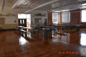 The cafeteria, on the building's top floor, has gleaming wood floors. The floors, which are original to the building, were beneath carpeting that was torn out.