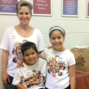 Christine Rosas and her children, Rolando and Angel, dispensed kindness, unconditional love and 1,500 cookies across Tampa Bay this summer. Here, they are making a stop at Trinity Café, which feeds homeless people. (Photos courtesy of Christine Ross)