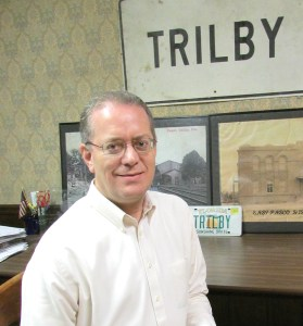 Scott Black, who grew up in Trilby, has such an intense interest in preserving Trilby's history that it borders on obsession. He has spent countless hours tracking the community's history through public records and newspaper accounts, and has a large collection of photographs and postcards, too. (B.C. Manion/Staff Photo)