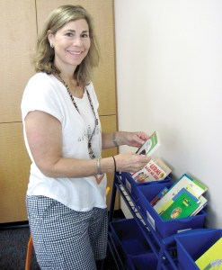 First-grade teacher Robin Kestenbaum is sorting out some books for the bins in her classroom.