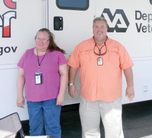 Julie Hayes, veterans' representative with CareerSource Pasco Hernando, and Frank Jones, van driver and veterans' outreach program specialist at the Pasco County Vet Center, brought services to veterans aboard the Pasco Mobile Vet Center. (Staff Photo)