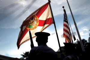 The Florida State flag catches a breeze and waves over the Wesley Chapel Cadet Squadron of the Civil Air Patrol's color guard. (File Photo)