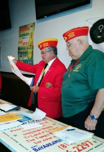 Florida Commandant Ron Ashley holds charter document, while L. David Kirk, commandant of the newly formed Marine Corps League Detachment No. 1440 looks on.