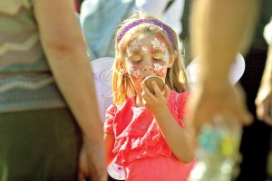 Zoe Deimling, 4, of Odessa, just can't stop looking at the art on her face after having it painted at the Lutz Arts & Crafts Show. Deimling was along with her grandmother, Denise Alliston of Odessa, and her great-grandmother, Susan Corcoran of Lutz.
