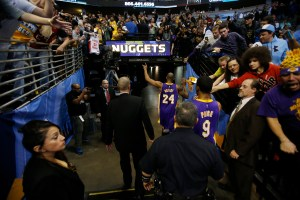 Dec 30, 2014; Denver, CO, USA; Los Angeles Lakers guard Kobe Bryant (24) and Los Angeles Lakers guard Ronnie Price (9) leave the stadium after the game against the Denver Nuggets at Pepsi Center. The Lakers won 111-103.  Mandatory Credit: Chris Humphreys-USA TODAY Sports