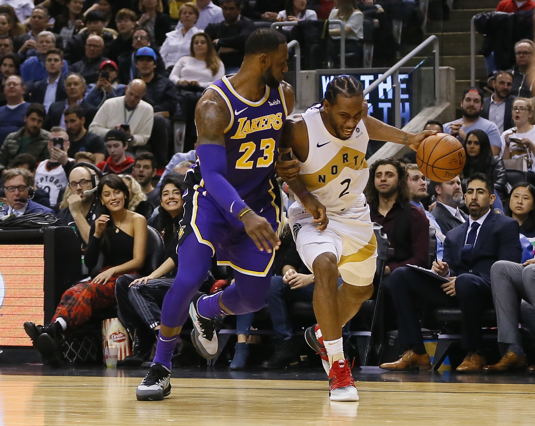 99bbedb702a Mar 14, 2019; Toronto, Ontario, CAN; Toronto Raptors forward Kawhi Leonard  (2) drives to the basket against Los Angeles Lakers forward LeBron James  (23) at ...