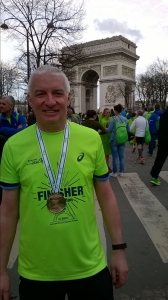 Roger Gill collects his medal in Paris