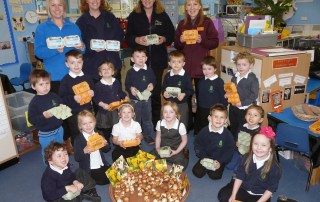staff and students with egg boxes and tulip bulbs