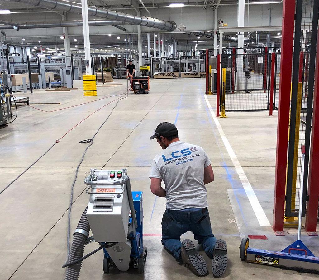 Flooring contractor working on concrete flooring in west michigan