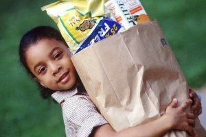 Child carrying grocery bag