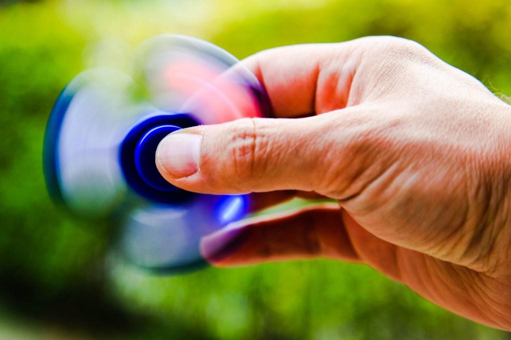hand holding fidget spinner