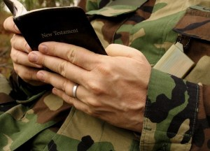 A solider reading the New Testament