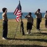 boy scouts saluting the american flag