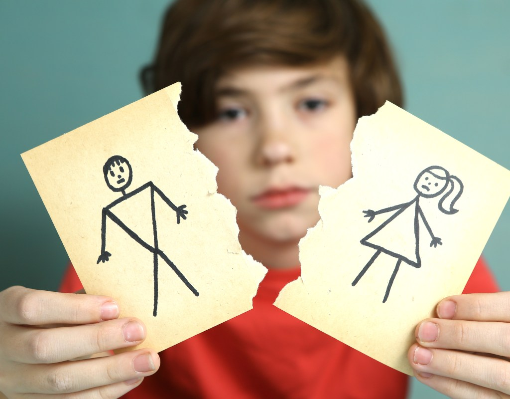Teen boy sad about parents divorce